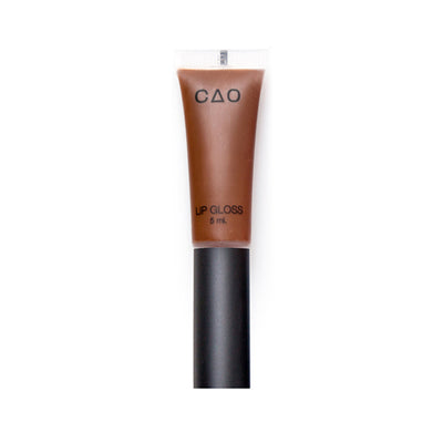 "Clear squeeze out lipgloss tube with black matte top filled with lipgloss product in the shade ""Cocoa"""