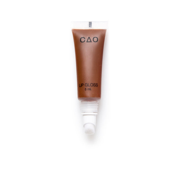 "Clear squeeze out lipgloss tube no top, cotton like lip applicator, filled with lipgloss product in the shade ""Cocoa"""