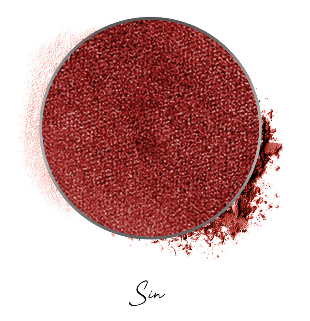 "a dark red colored individual eyeshadow compressed powder refill in shade ""sin"""
