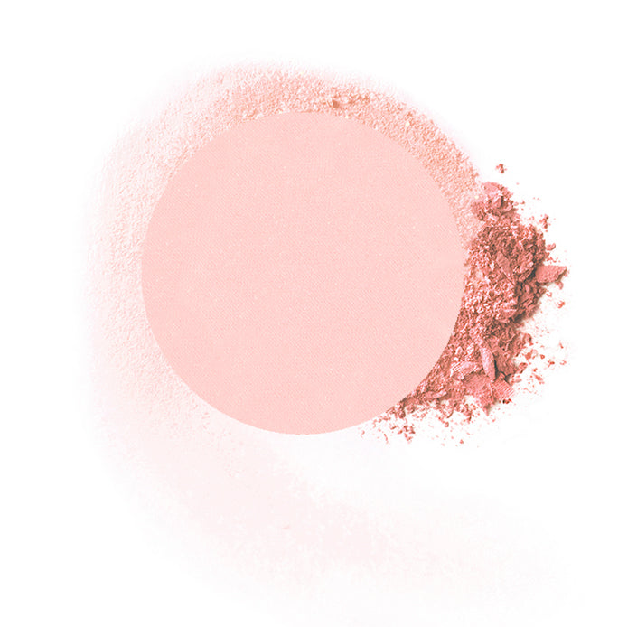 "Round compressed  powder blush refill shade in ""American Beauty"" on top of loose powder swatch."