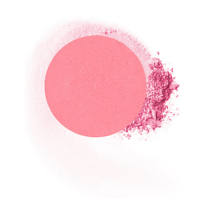 "Round compressed  powder blush refill shade in ""Delicious"" on top of loose powder swatch."