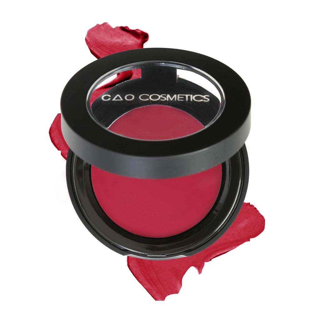 "Round Matte Black Component, clear round top window, filled with round creamy dual lip and cheek product shade in ""Desire"" on top of creamy swatch."