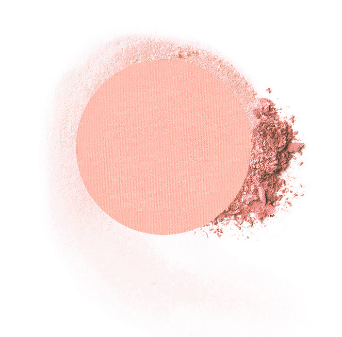 "Round compressed  powder blush refill shade in ""Goddess"" on top of loose powder swatch."