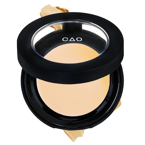 "Round Matte Black Component, clear round top window, filled with round creamy concealer shade in ""Lite"" on top of creamy swatch."