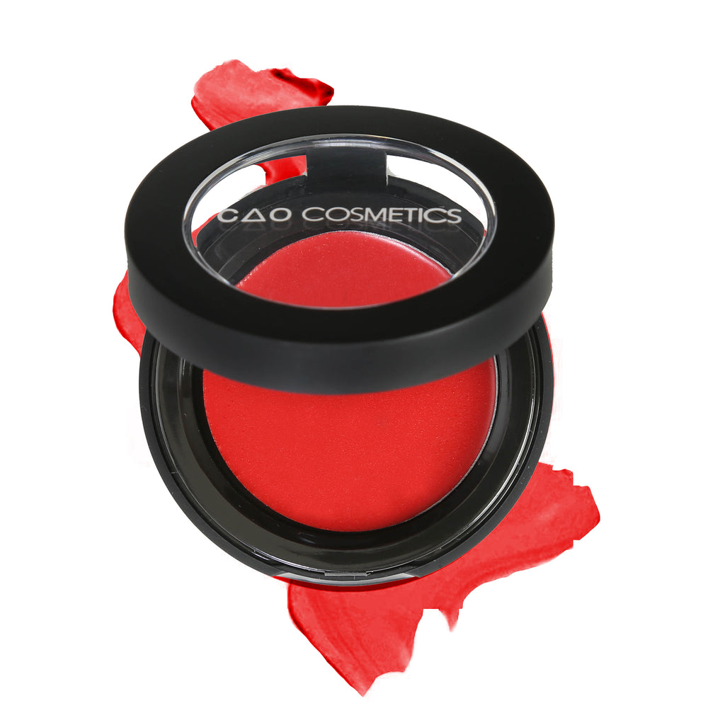 "Round Matte Black Component, clear round top window, filled with round creamy dual lip and cheek product shade in ""Rapture"" on top of creamy swatch."