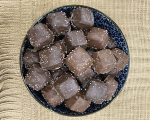 Milk and dark sea salt caramels in a navy blue dish at Cora Lee Candies