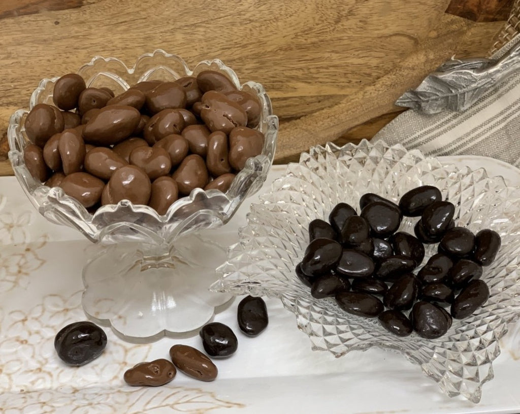 Chocolate Covered Raisins in a dish, both milk and dark chocolate