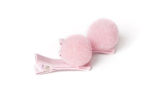 Pair of pink pom pom hair clips