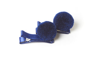 Pair of blue pom pom hair clips
