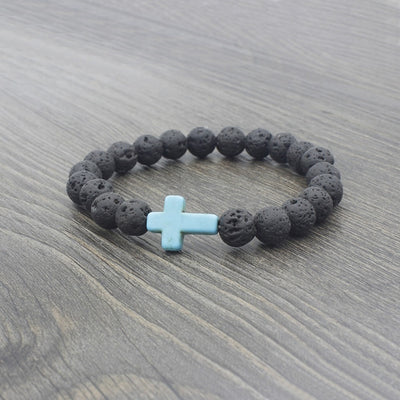 black lava stone stretchy bracelet withlight blue stone cross