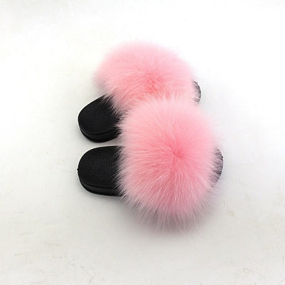 light pink kids fox fur slides slippers with black rubber soles