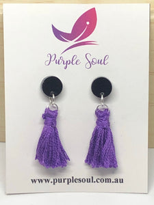 purple tassels on black studs