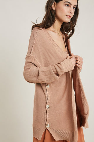 Remixmess pocket front raw edge poncho blouse in latte