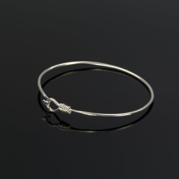 Alpha bangle in sterling silver by Rouaida.
