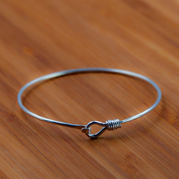 Sterling silver Alpha bangle by Rouaida.