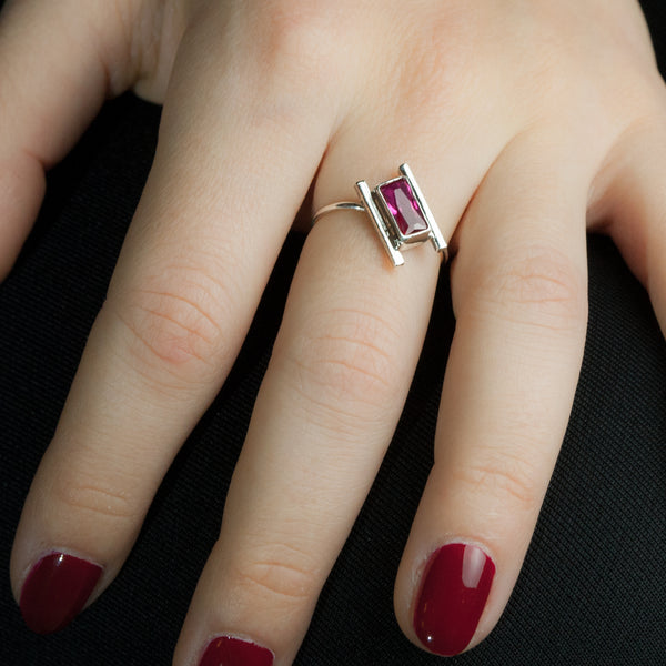 Sterling silver Artemis ring with ruby by Rouaida on woman's hand.