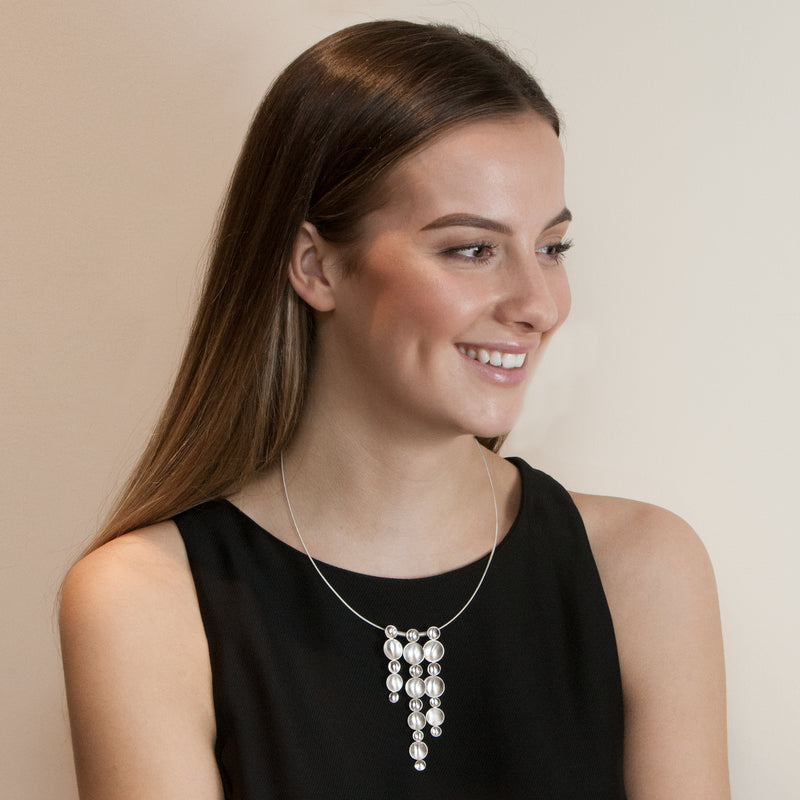 Model wearing sterling silver Cascade necklace by Rouaida.