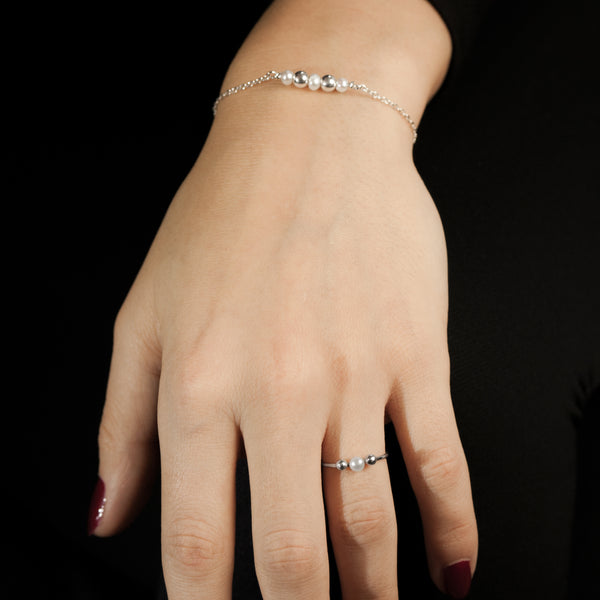 Sterling silver Celestial ring and bracelet by Rouaida on model's wrist.