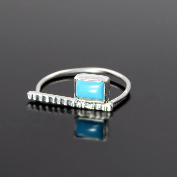 Sterling silver Codex ring with turquoise stone by Rouaida.