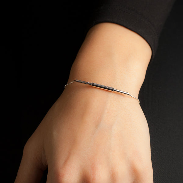 Sterling silver Concentric bracelet by Rouaida on model's wrist.
