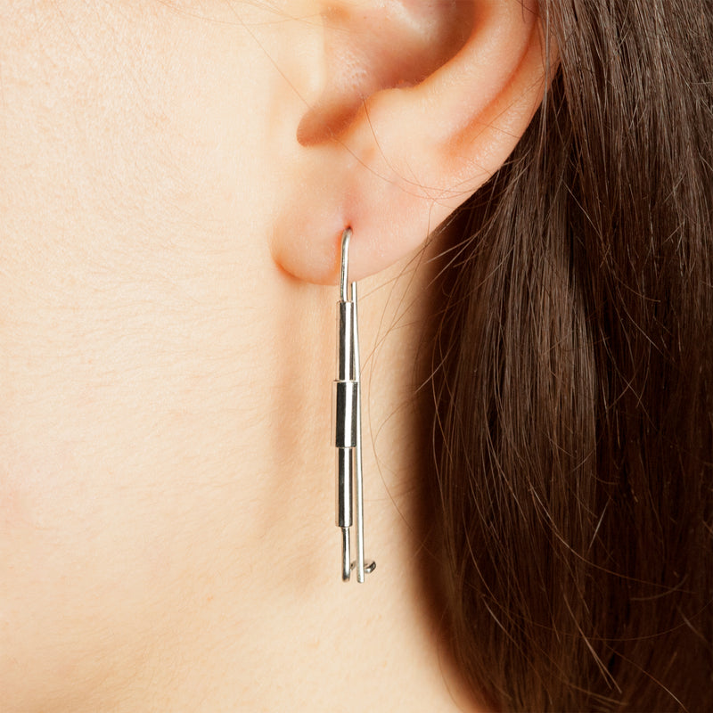 Model wearing sterling silver Concentric earrings by Rouaida.