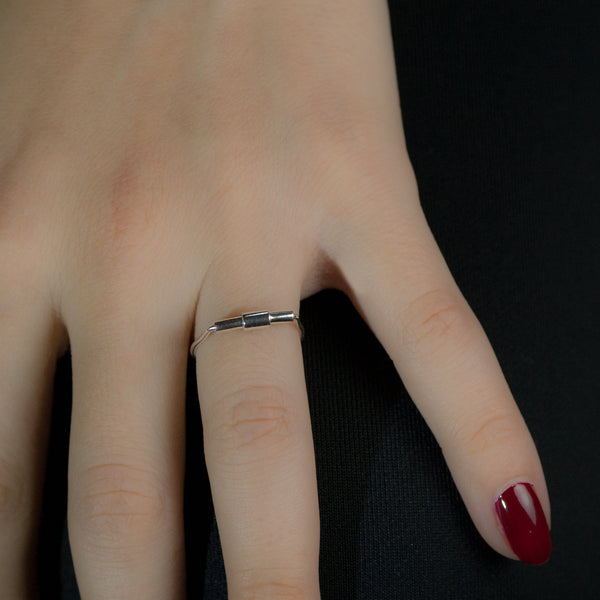 Sterling silver Concentric ring by Rouaida on model's hand.