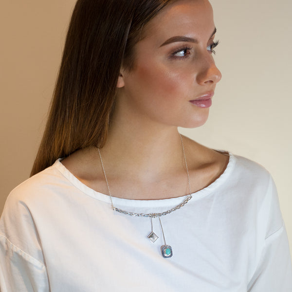 Woman wearing Athena necklace by Rouaida.