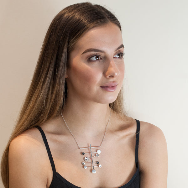 Model wearing Constellation necklace by Rouaida.