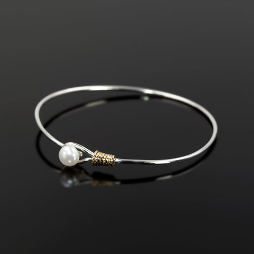 Grace bangle by Rouaida with gold and pearl accents.