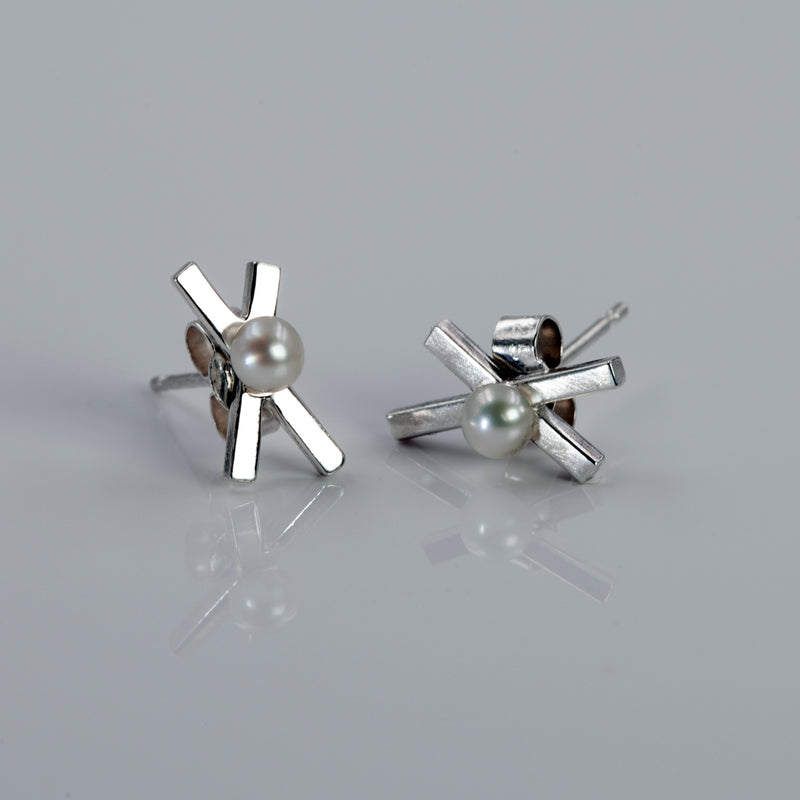 Sterling silver Intersection studs with freshwater pearl by Rouaida.