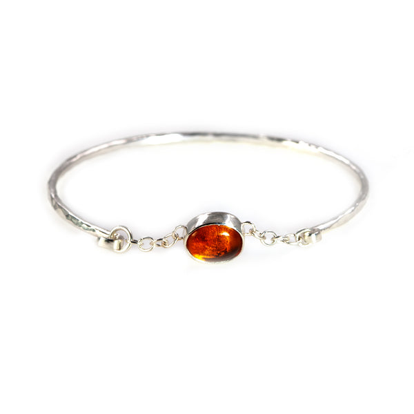 Sterling silver Melody bangle with amber stone by Rouaida.