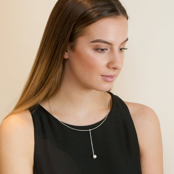 Model wearing Purity necklace by Rouaida.