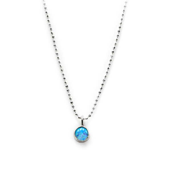 Sterling silver Singularity necklace with blue opal stone by Rouaida.