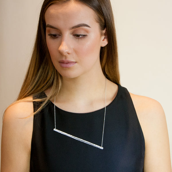 Model wearing Split Singularity necklace by Rouaida.