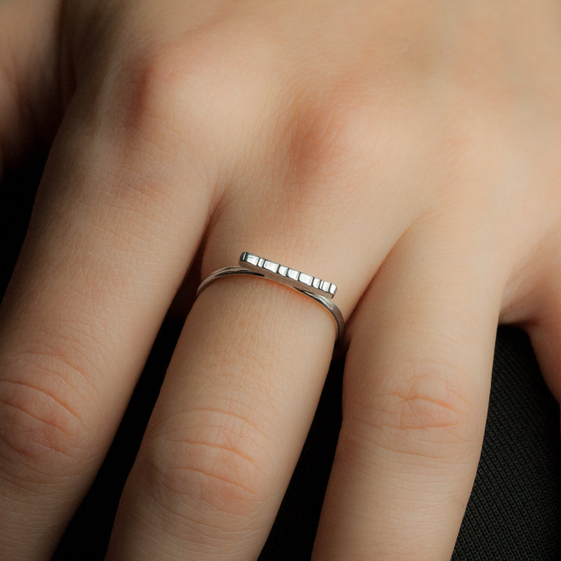 Staccato ring on model's hand.