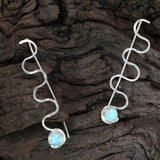 Sterling silver Ripple earrings with opal stones by Rouaida.