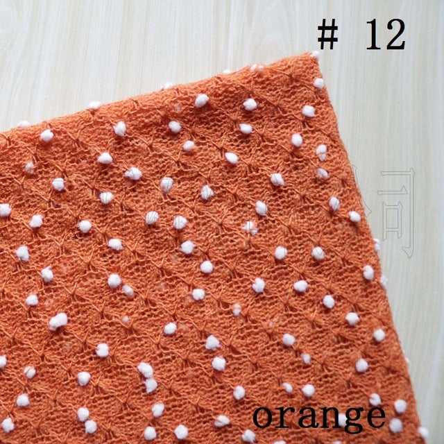 orange knit baby blanket