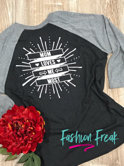 Mom Loves Me Most | Black & Grey Raglan Baseball Tee | Fashion Freak LLC | Apple Valley, MN