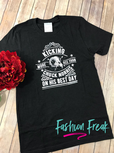 Kicking More Ass Than Chuck Norris Exclusive Graphic T by Fashion Freak LLC | Unisex Heathered Black