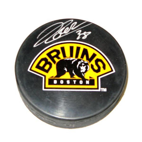 "Autographed Jordan Caron  Boston Bruins ""Bear"" Logo Puck. Jordan Was Drafted 25Th Overall By The Bruins In 2009. He Scored His First NHL Goal On October 16, 2010 Against Martin Brodeur.  Comes With Sports Images Hologram And Cert. - Peazz.com"