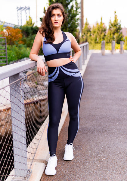 Sustainable activewear made in the usa sports bra and high waist yoga pants in color blue and black on fitness model