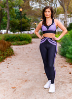 Fitness Brand Model wearing horizon active activewear outfit in colors black and purple on a park pathway in NYC during fashion week