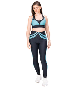 Activewear outfit with a base color black with an ocean green design over it, it includes sports bra and high waist leggings