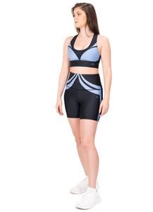 Activewear outfit with a base color black with a blue design over it, it includes sports bra and high waist biker shorts