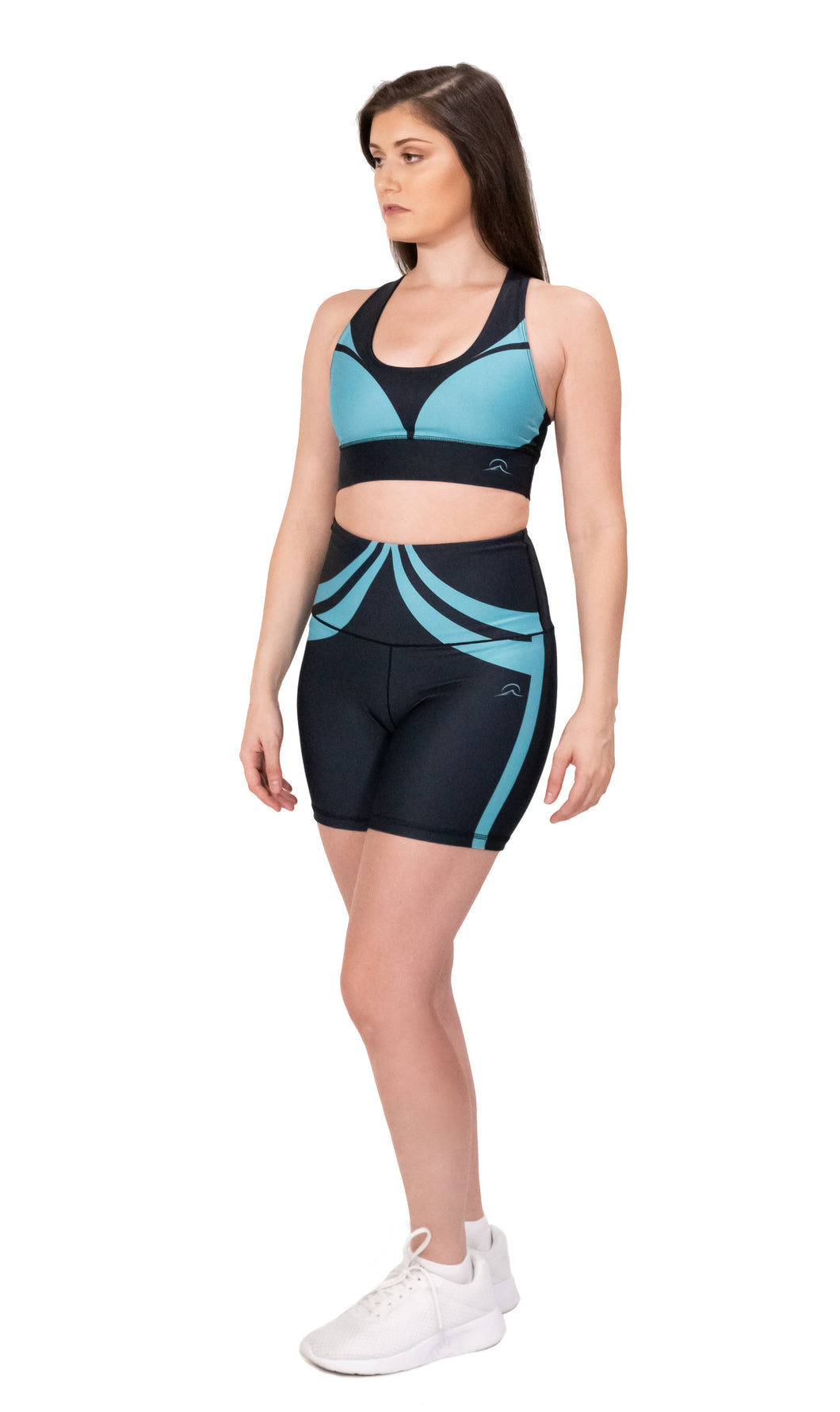 Yoga outfit with a base color black with an ocean green design over it, it includes sports bra and high waist biker shorts