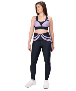 Yoga outfit with a base color black with a violet purple design over it, it includes sports bra and high waist leggings