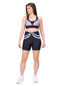 Activewear outfit with a base color black with a violet purple design over it, it includes sports bra and high waist biker shorts