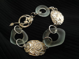 Etched glass and silver bracelet