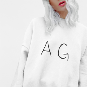 Front view of woman wearing AG sweatshirt