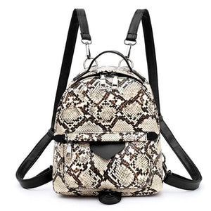 Snake skin print backpack with dual zippers and leather straps